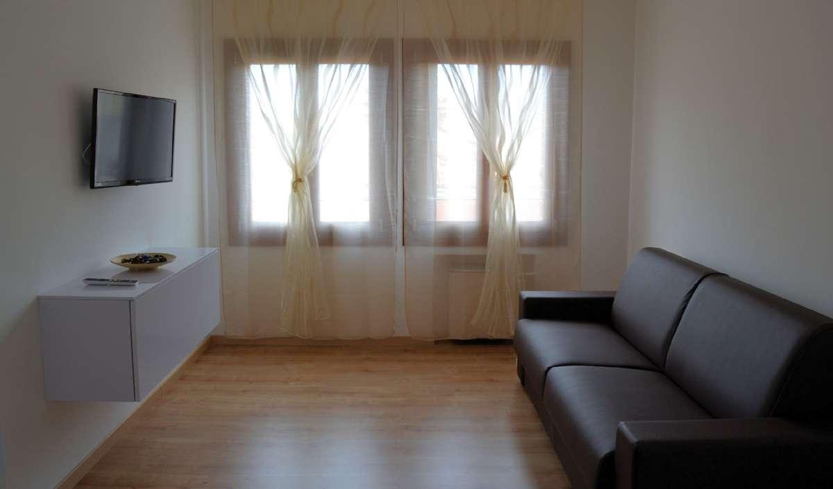 Eksempel på sovesofa i stuen i Comfort suite