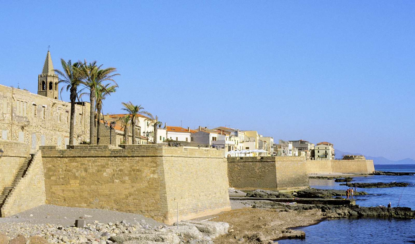 Alghero original castle wall from the Middle Ages and the Cathedral of Santa Maria's beautiful, Gothic bell tower