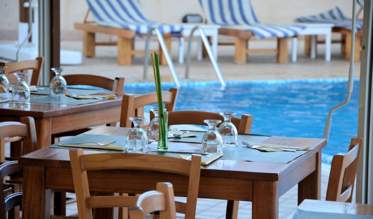 Dine right next to the pool at La Terra dei Sogni