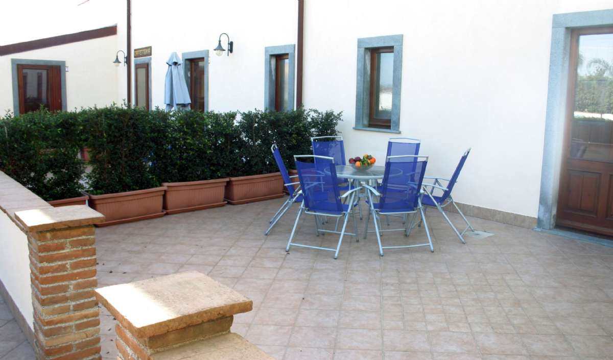 Outdoor area with table and chairs on the ground floor