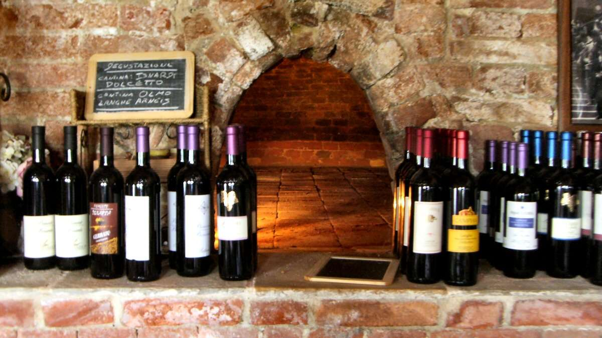 Wine in front of the ancient stone oven
