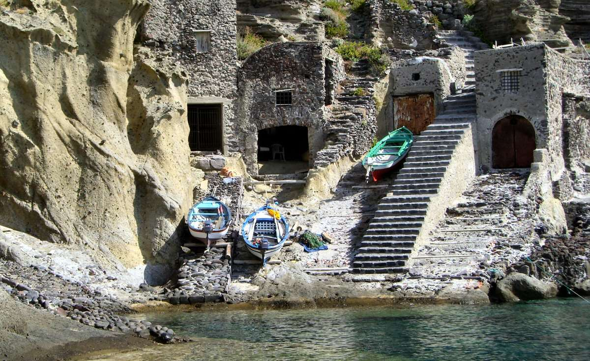 The boats pulling up in caves