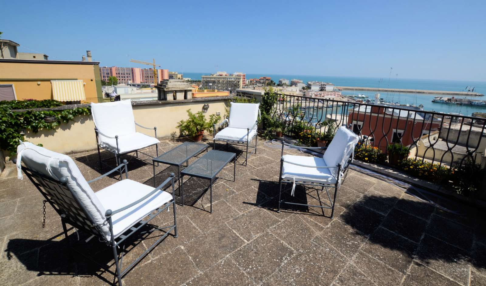 One of the four beautiful rooftop terraces overlooking the harbour and the sea